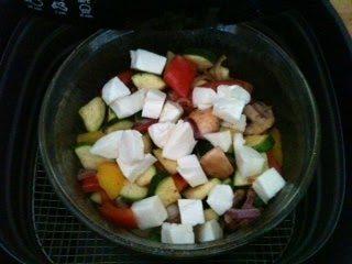 Gemüse mit Käse belegen