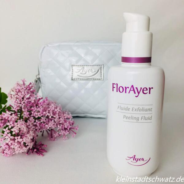 FlorAyer Peeling Fluid mit Tasche im Hintergrund