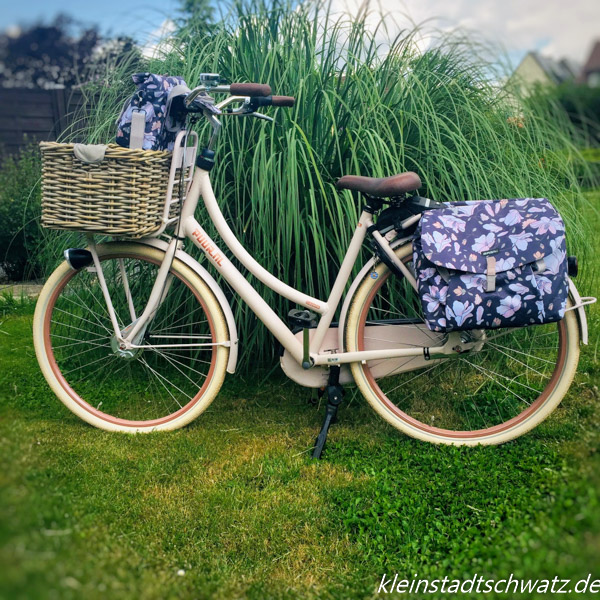 Lastenrad Gazelle Puur_Nl mit Taschen und Korb von Basil um die Einkäufe sicher zu transportieren